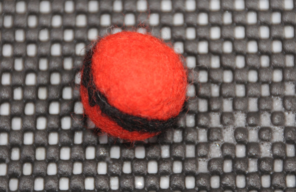 Secure with a felting needle