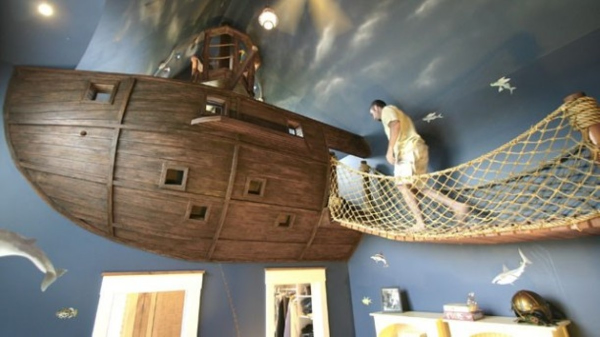 Crows nest bed with rope planked walkway to board the ship. Any kid would want this in their bedroom.