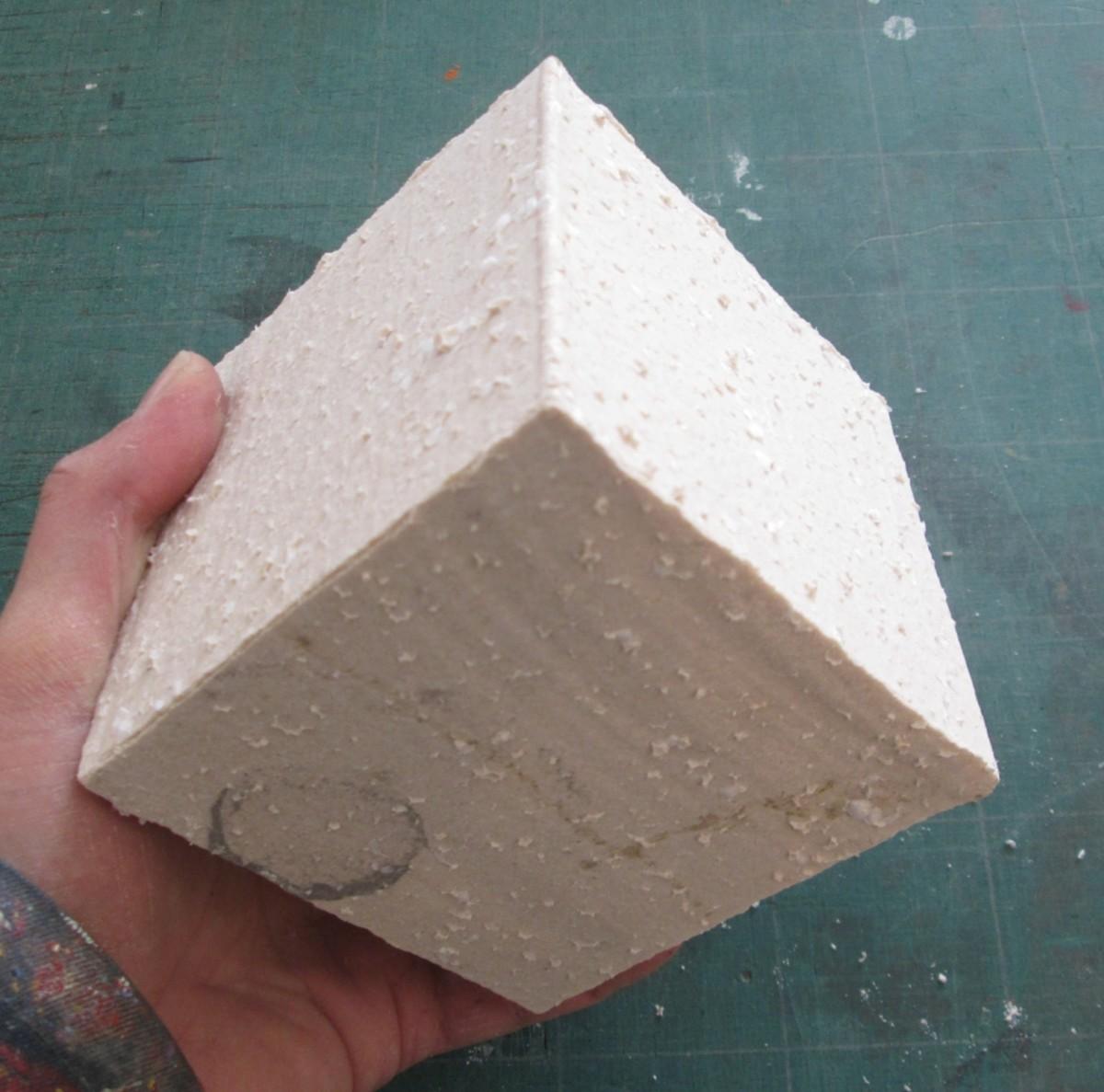 Rough cast jesmonite cubeoid.