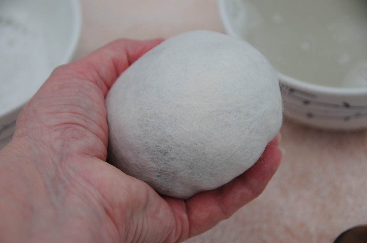 Roll on a towel until you have a nice rounded ball