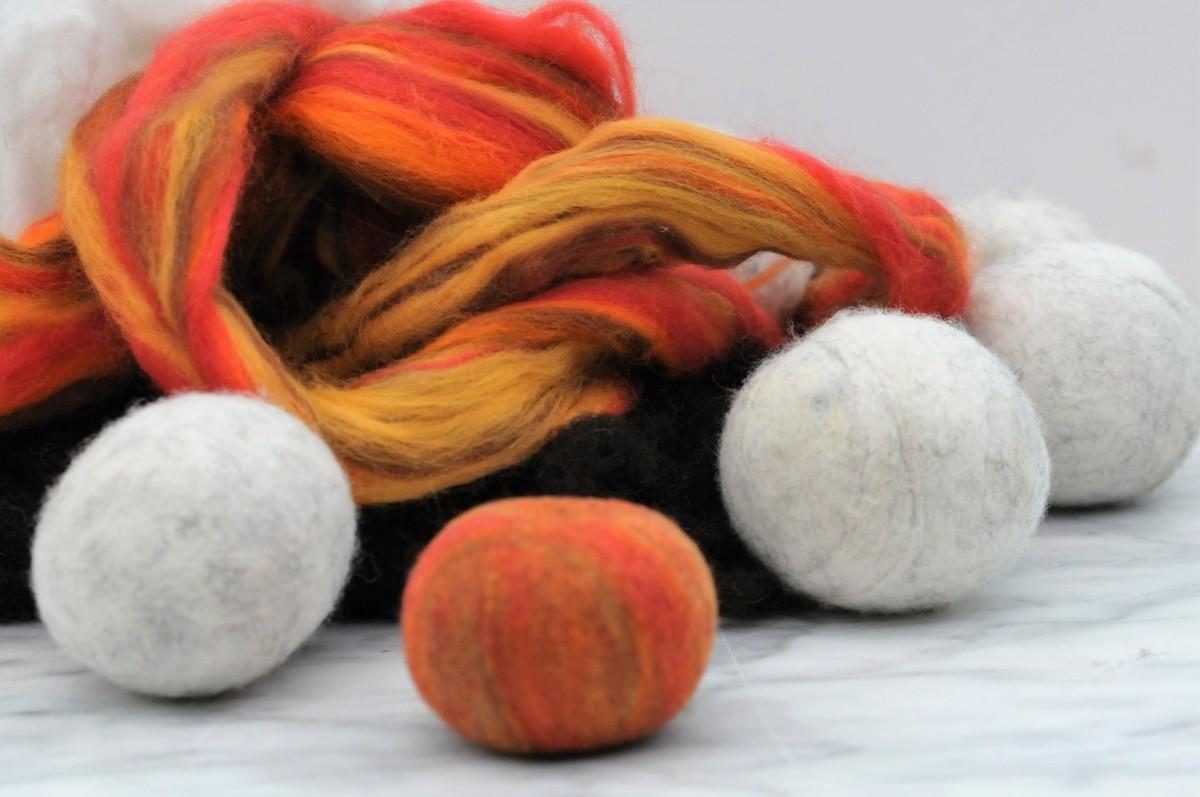 Waste wool roving, white, brown and russet merino wool roving.