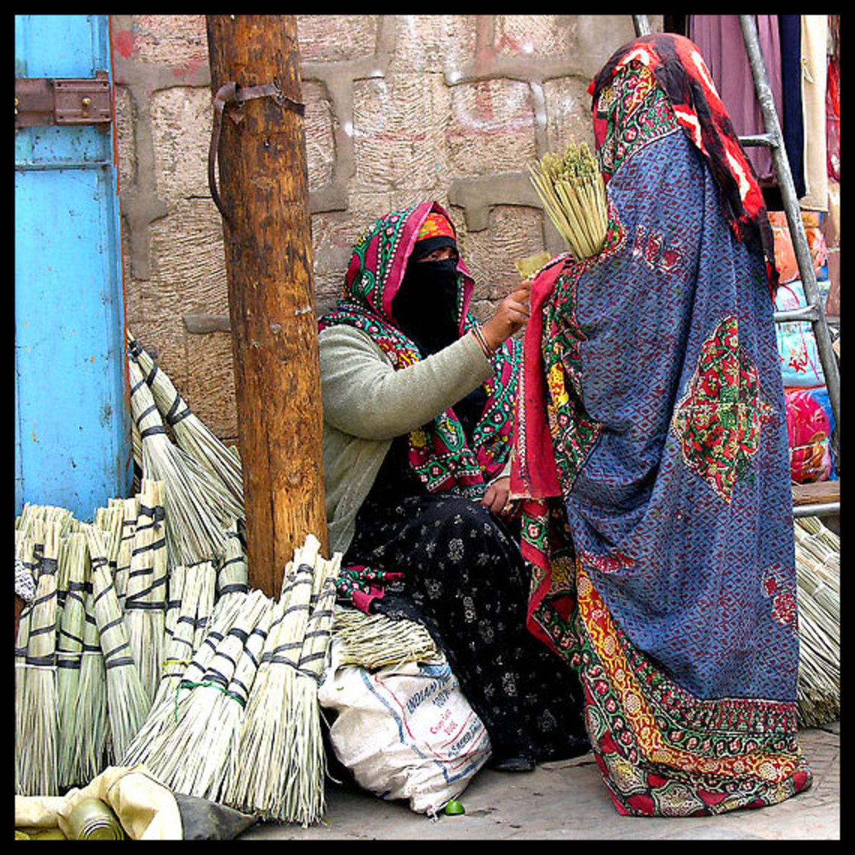 A female Yemeni seller wearing the Sana'ani Sitarah in a local market of Sana'a city