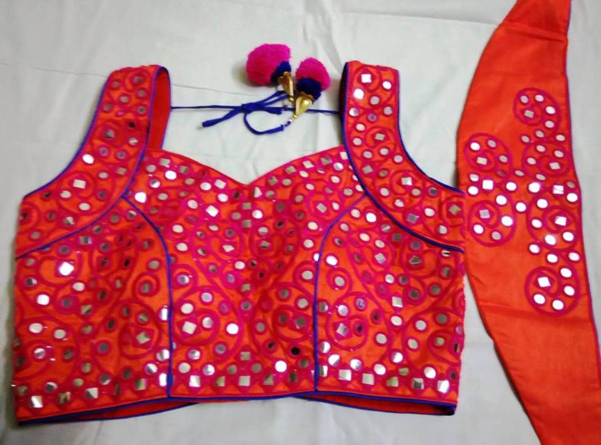 orange and red sleeveless blouse with mirror designs for saree