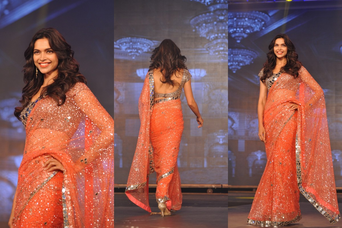 Deepika in orange saree with very gorgeous all over mirror work designer blouse