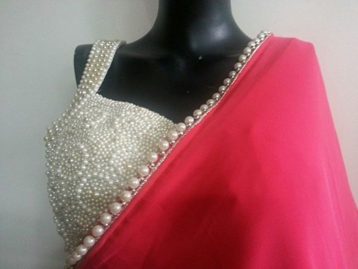 Full heavy pearl encrusted sleeveless blouse which can be worn with one color pink saree