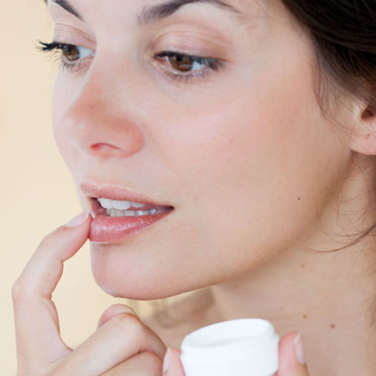 Apply lip balm or chapstick to moisturize your lips.