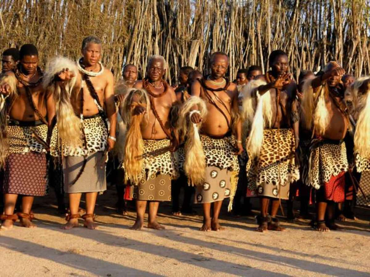 Older Swazi men wearing traditional clothes