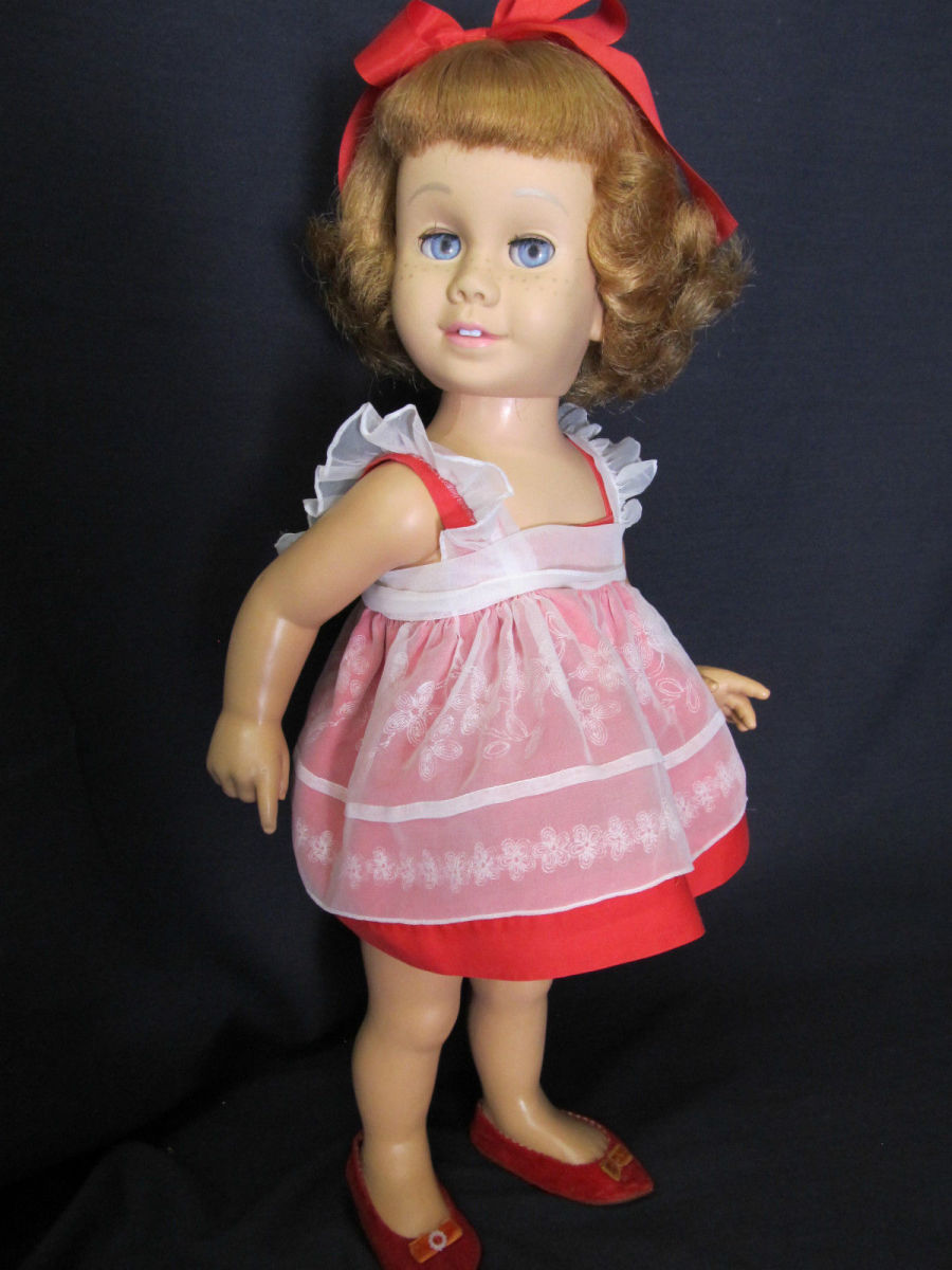1960 Chatty Cathy, she is a prototype, with strawberry blonde hair, and blue eyes, with the Mamie Eisenhower flip hairstyle, bought right out of the Harvey's Department Store window before Christmas back in 1960, she even had her own highchair.