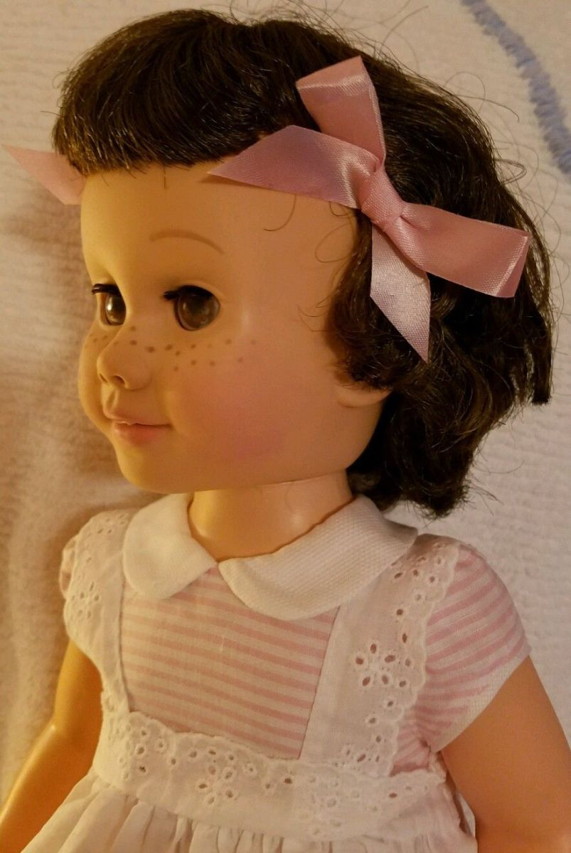 This vintage Chatty Cathy has excellent hair in original set, and her lashes are also excellent. Freckles and face paint excellent original. Head limbs same color, which is always a plus. .
