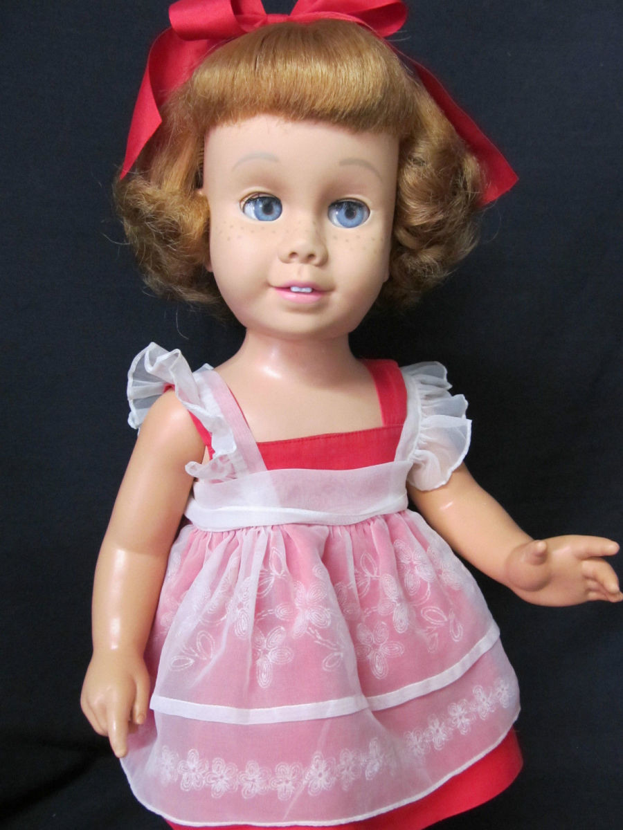 Doll & clothes are both very clean with no fading, rips, tears or damage, riveted snap closures on sun suit & pinafore are intact. Original red velvet Chatty shoes have some wear, the toe bows are a little faded.