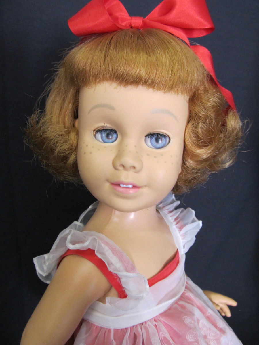 "She is called a ""prototype"" as the first dolls were not marked on either the head or body.  She is hard vinyl with a soft vinyl head and a fabric covered grill in the chest. Her neck turns and all joints work easily."