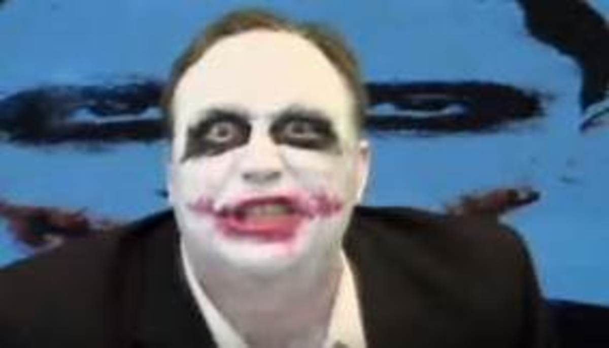 Alex Jones donning a Joker face.