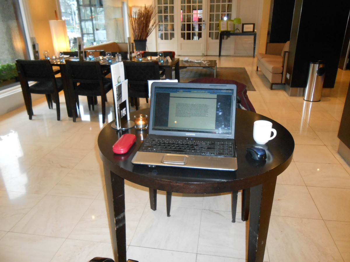 "My ""office"" in the lobby of the hotel from where I drank coffee and watched the snow fall on my first morning in Amsterdam! Notice each table even has a lit candle which added to the ambiance!"
