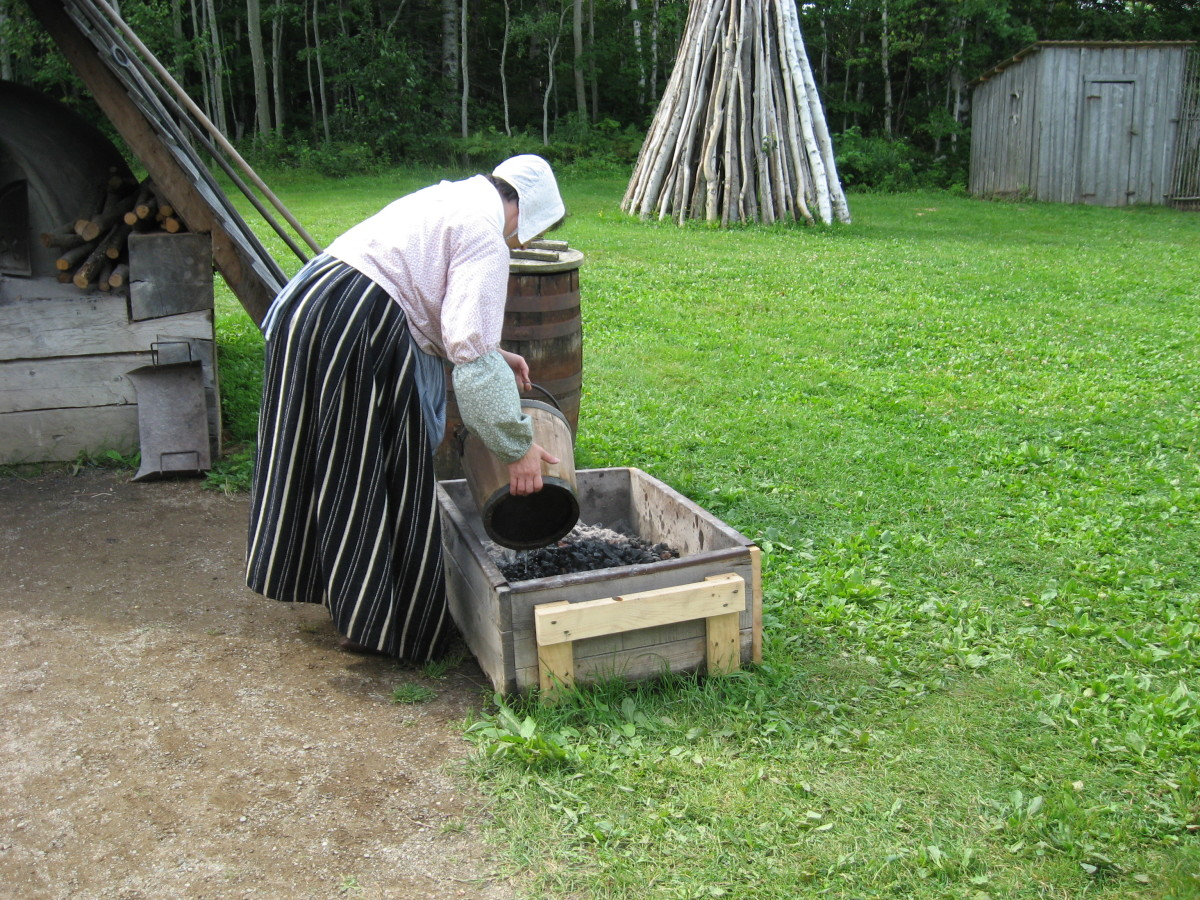 A docent reenacts the activities of an Acadian woman of the 1700s in New Brunswick, Canada.