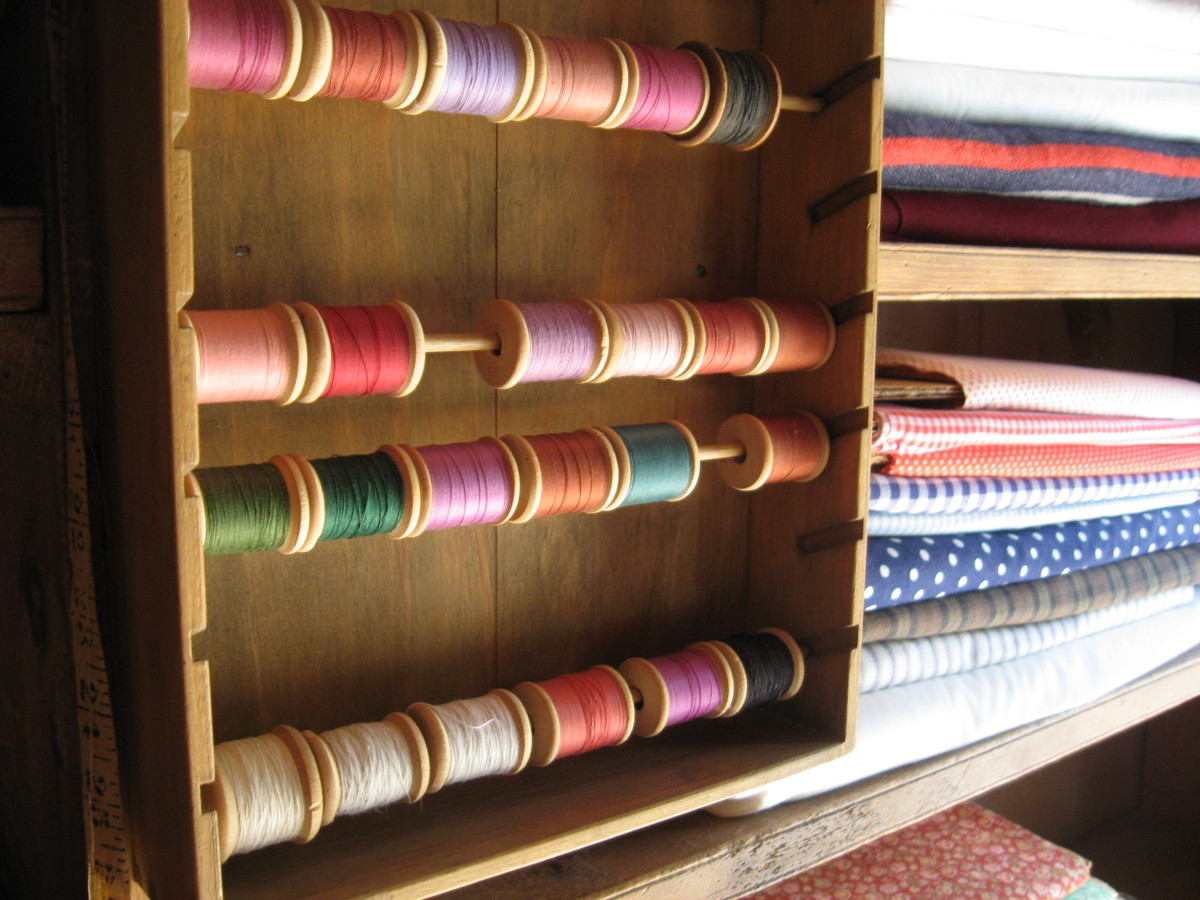 At the general store, Acadians could buy thread of different colors and patterned cotton fabric. Many Acadians lived in isolated communities with limited access to goods like these.