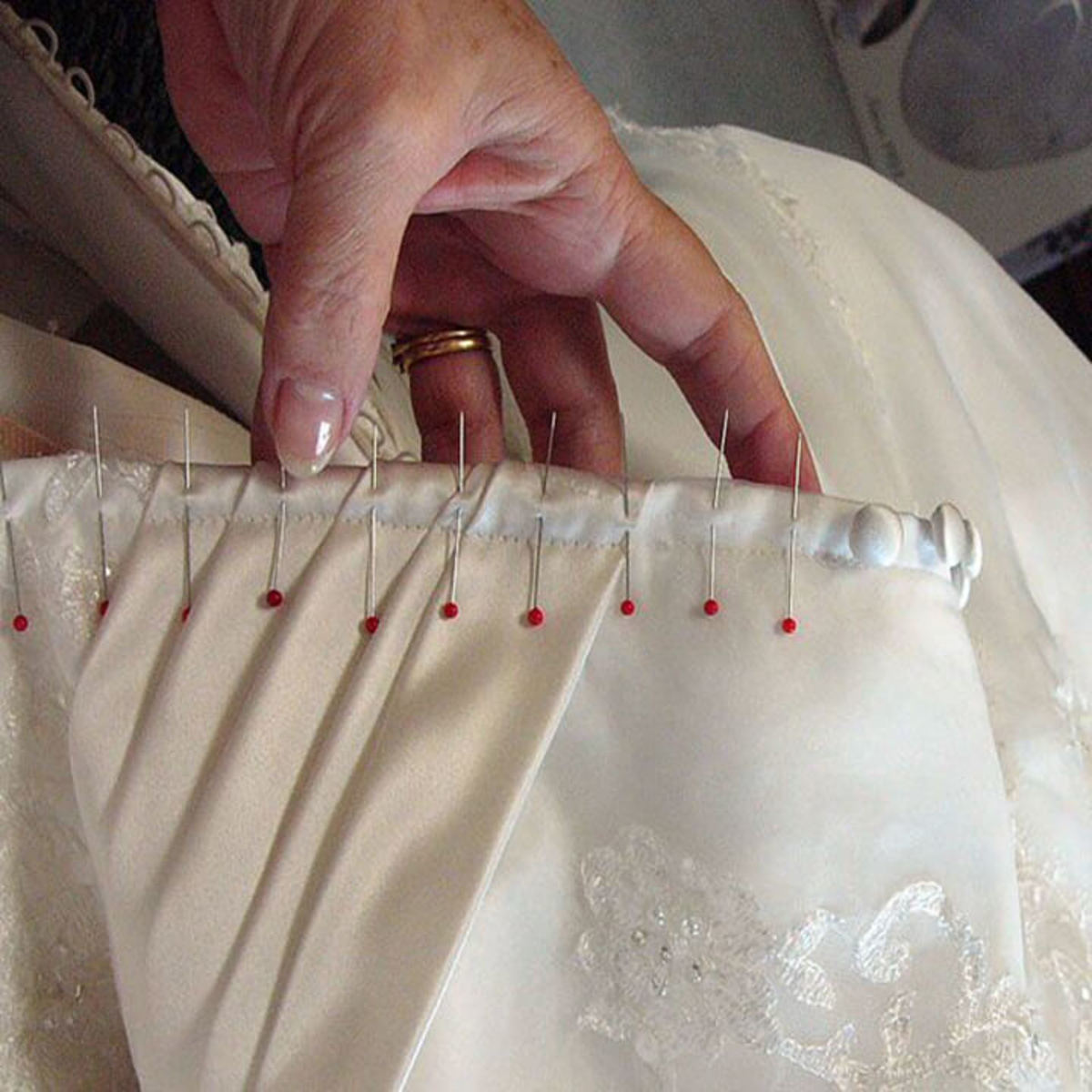 Needles and pins bad luck left in a wedding dress