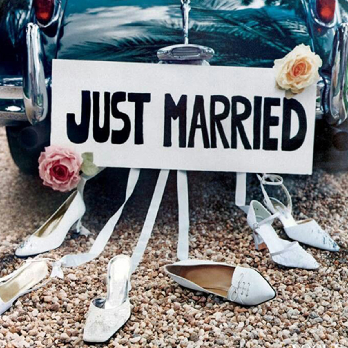 Just married shoes tied to car good luck