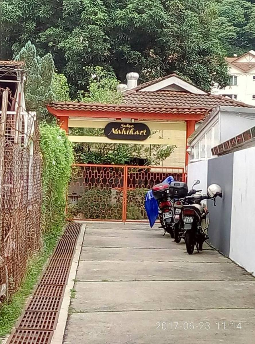 The narrow path leading to the gate of Penang Mahikari Center