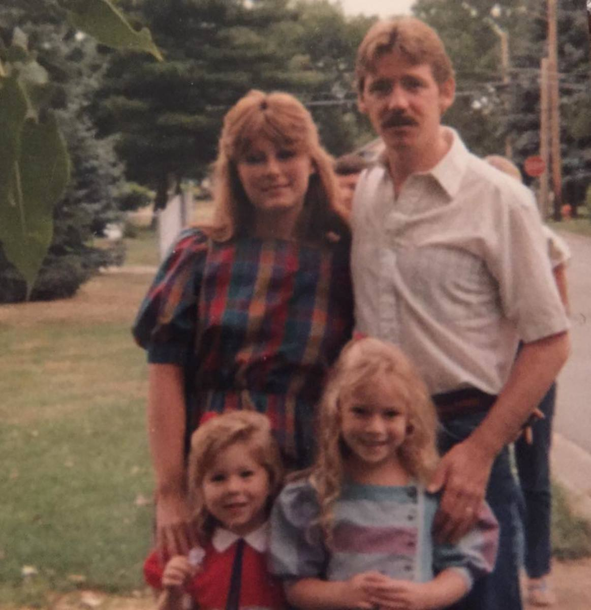 My family in the late 1980s; that's me, bottom left.