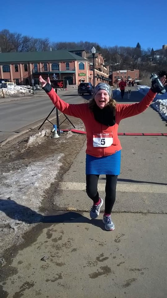My Wife Kayle Rice finishing the Run with the Cops 5K race in Marquette March 24 2018