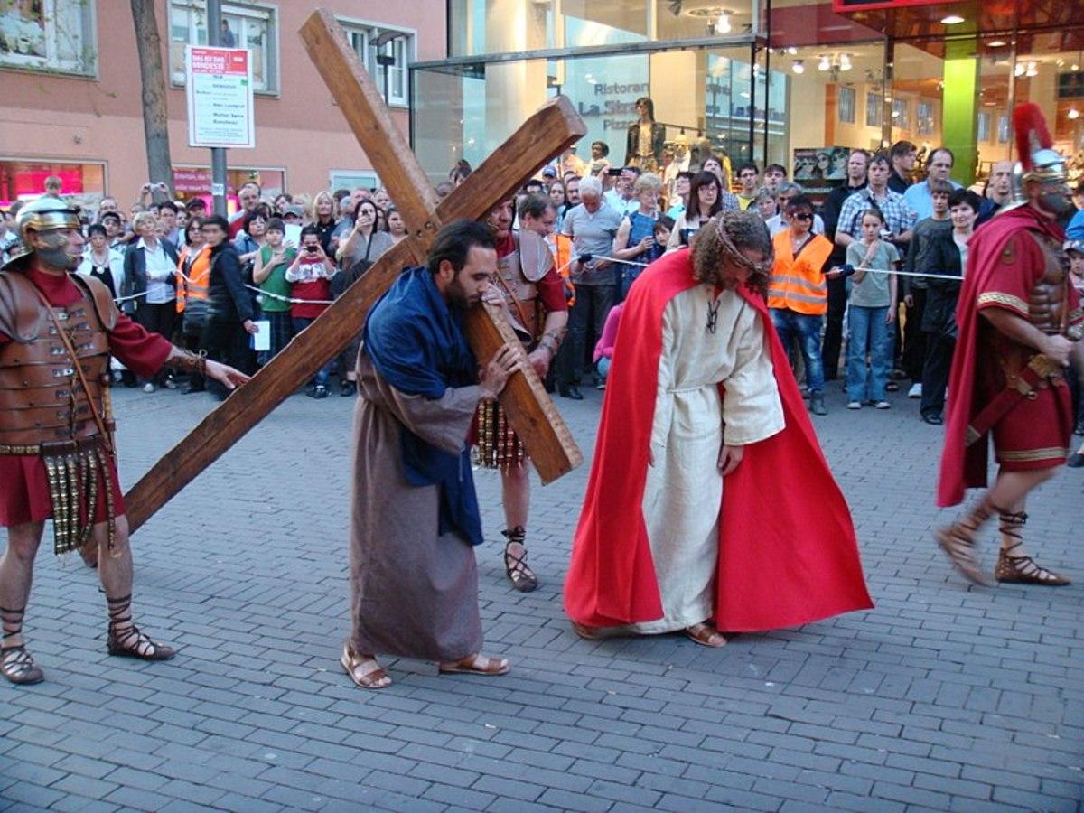 Artwork of Simon of Cyrene Carrying the heavy cross for Jesus
