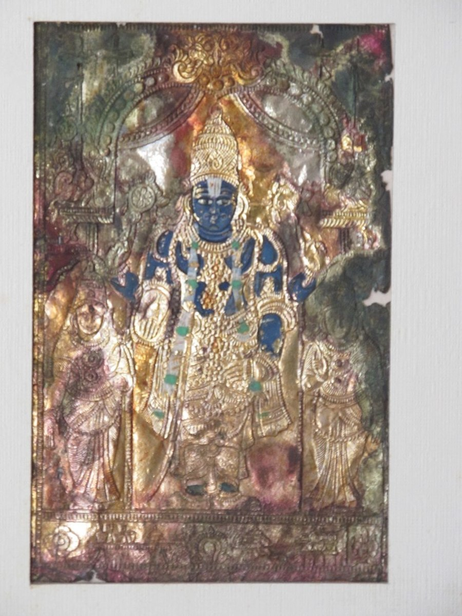 A painted brass repousse of Tirupati Balaji. Circa 19th century CE.