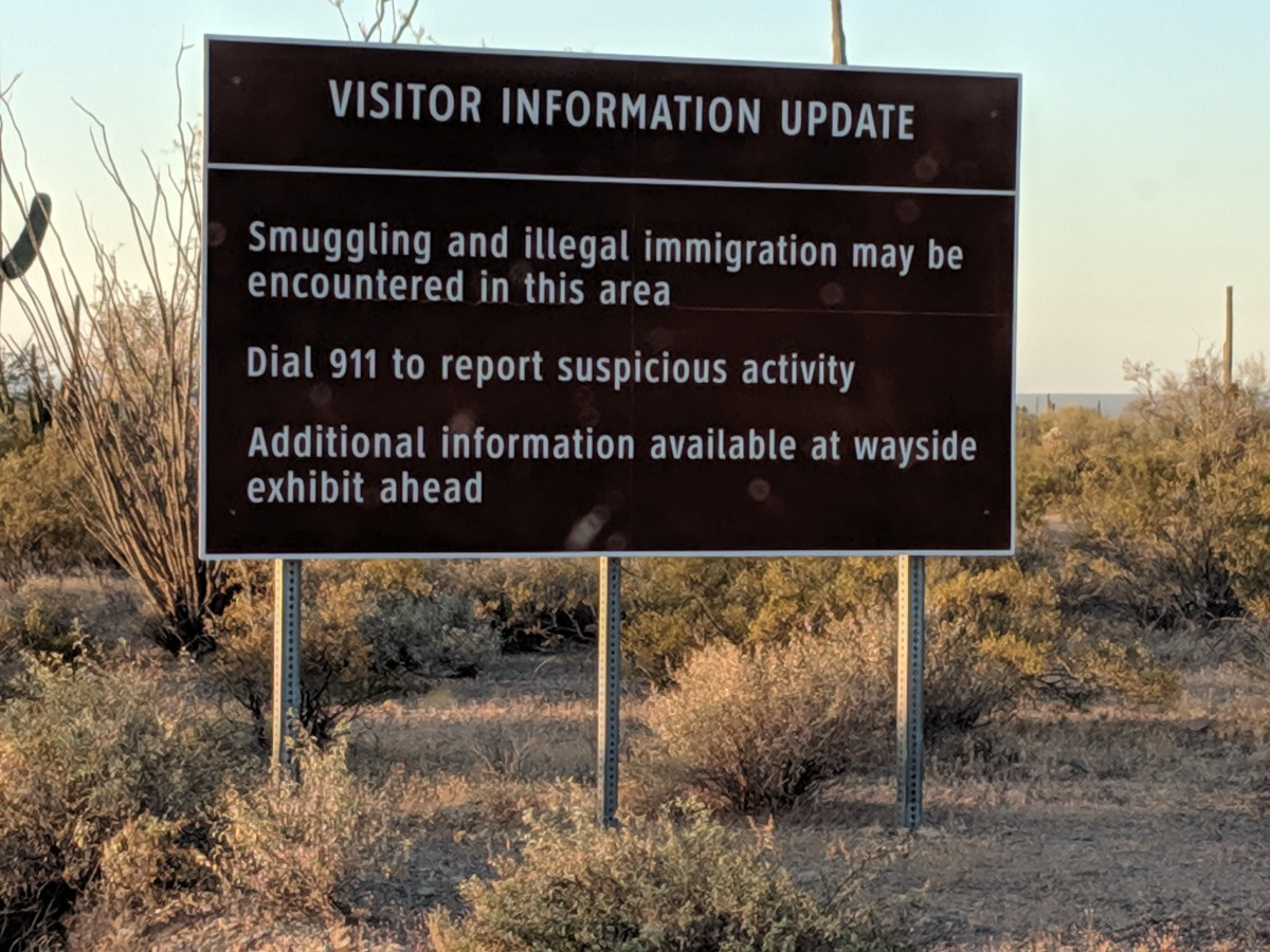 Sign warning about possible smuggling and illegal immigration taking place in area..  Sign further down road recommends being alert and not going off designated trails for hiking to avoid encounters.