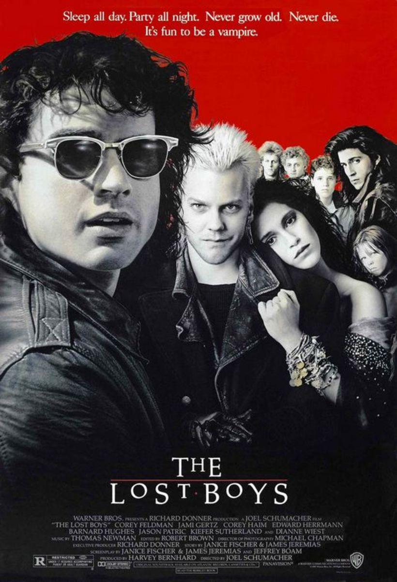 The vampire on the very right's head is bigger than Corey Haim. Or Maybe it's just the 80s hair.
