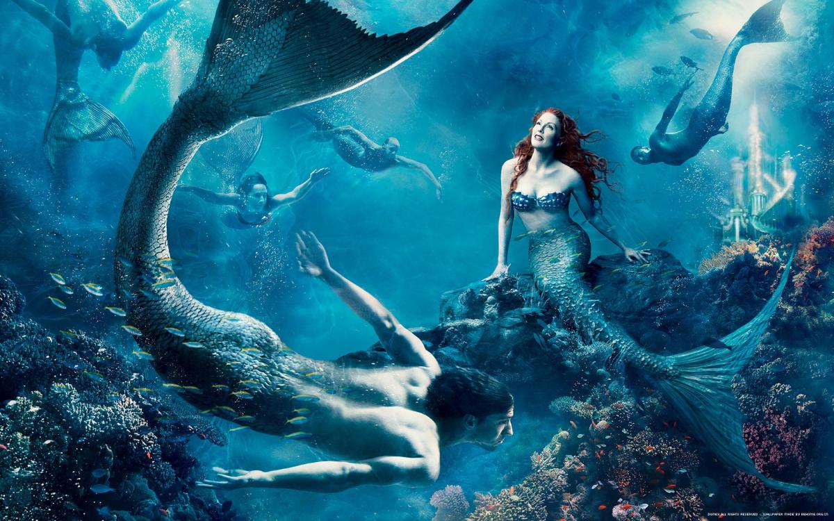 Male and Female mermaids in an art piece.