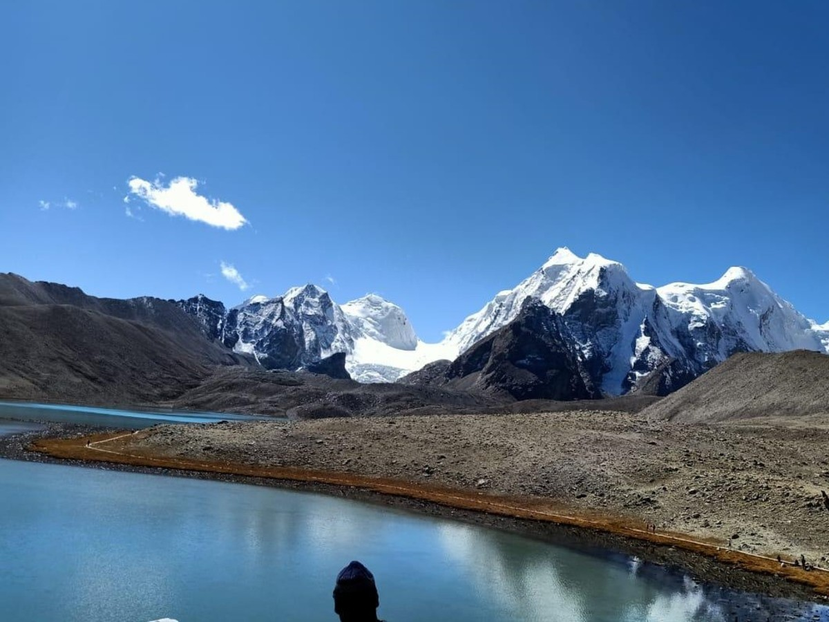 The pristine lake, snowy peaks, the blue sky create a magical moment