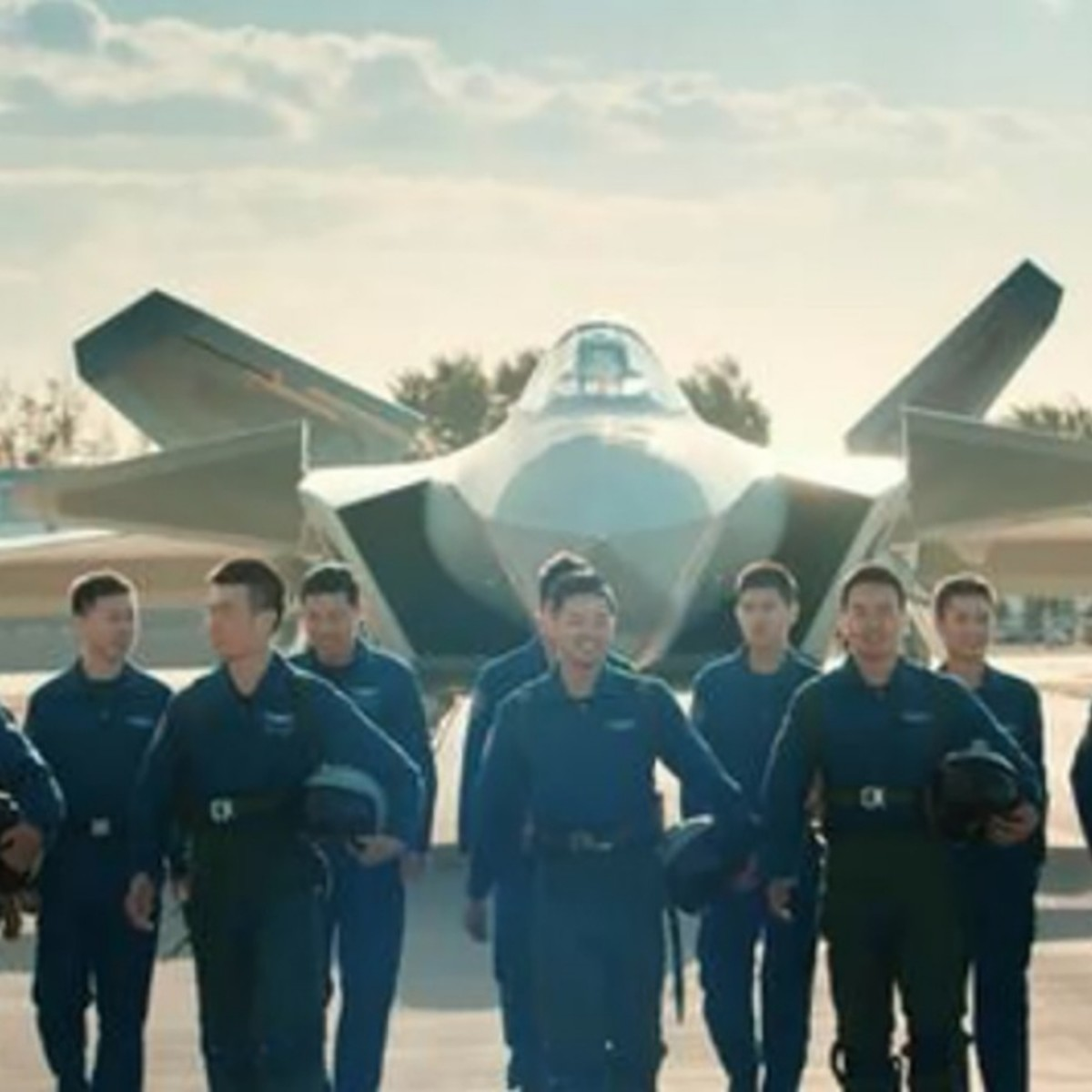 Pilots posing with the J-20 stealth fighter.