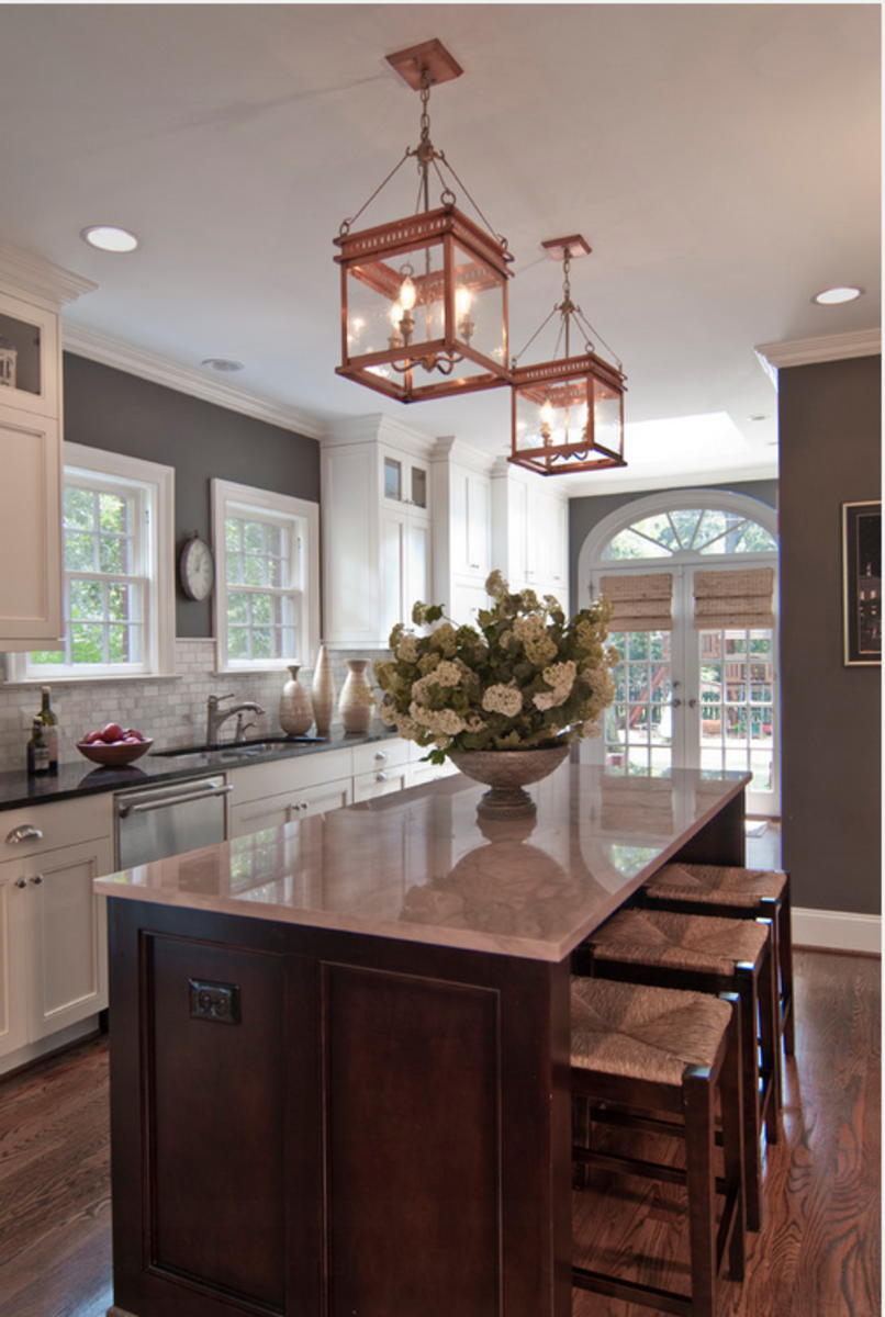 The copper lanterns warm up the gray walls to create a classy kitchen.