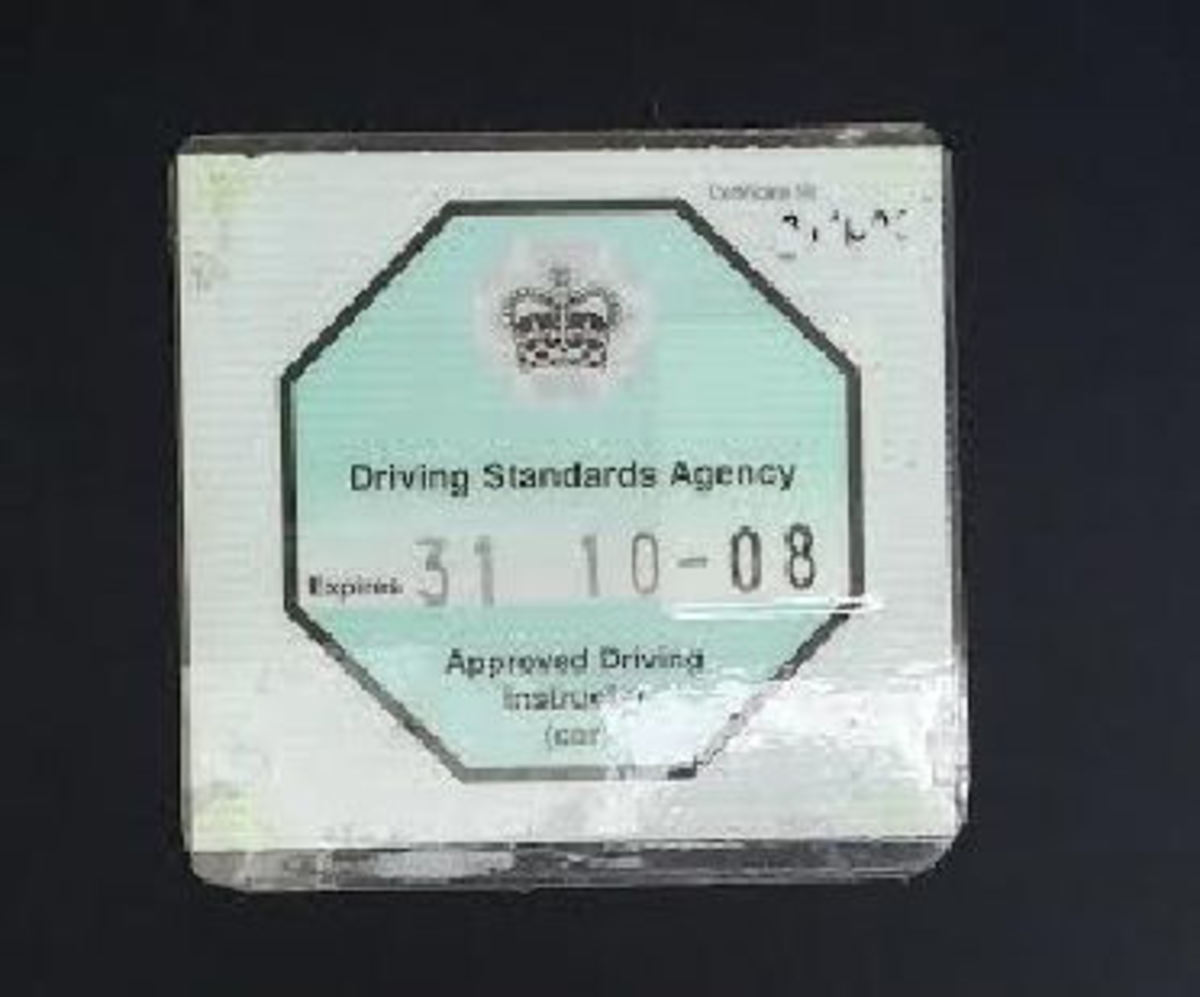 Fully qualified Approved Driving Instructors (ADIs) display a green octagonal badge