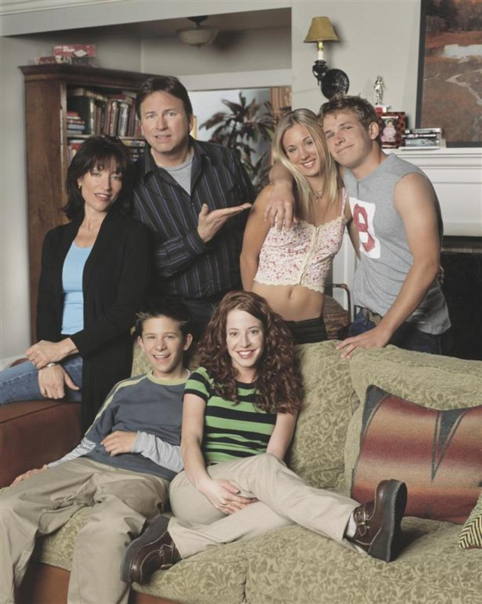 Ritter with the cast of 8 Simple Rules