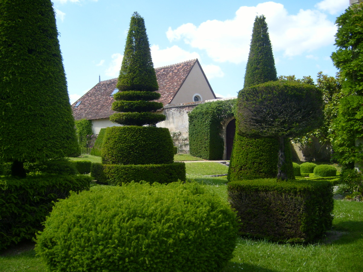 Topiary garden at Chateau d'Azay-le-Ferron, with trees shaped to resemble chess pieces