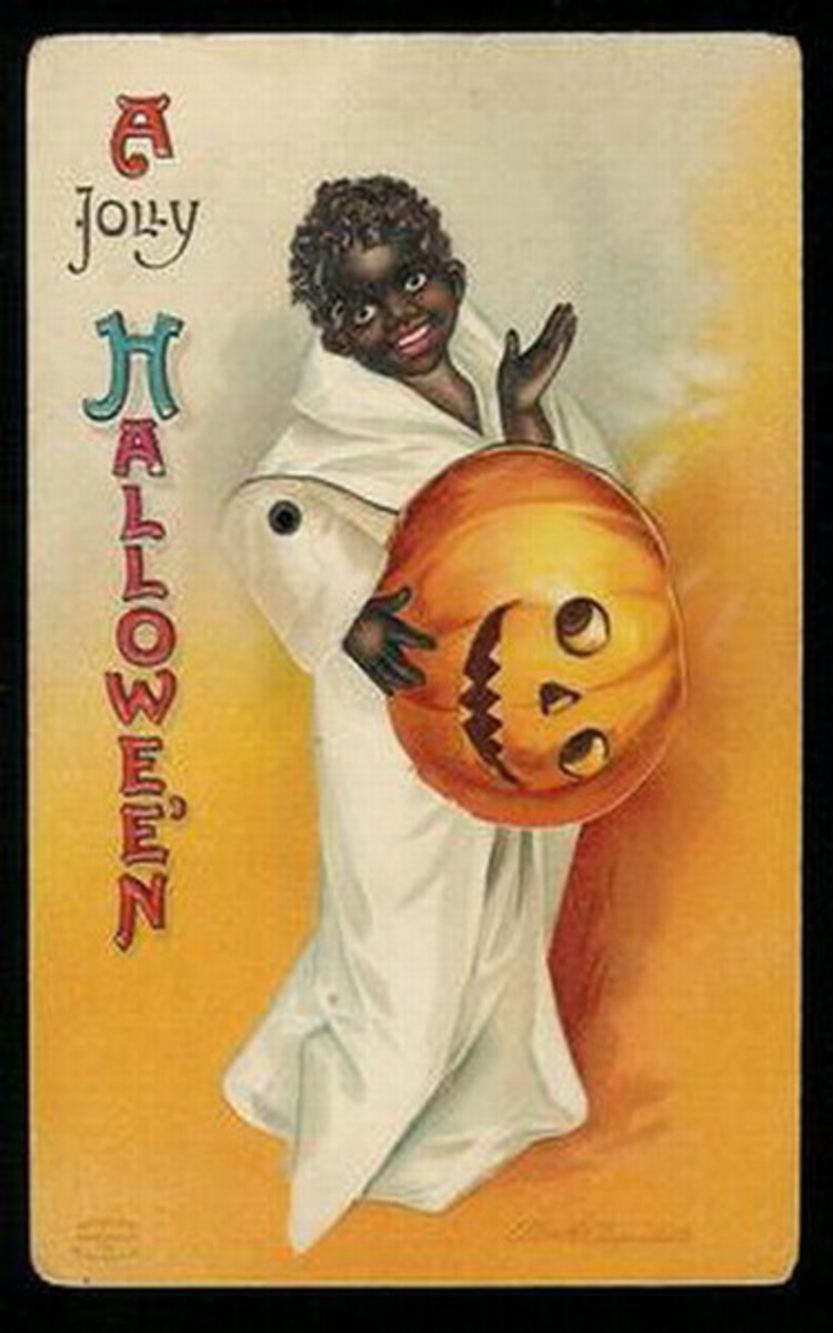 Vintage Halloween card: African American boy with carved Jack-o-lantern