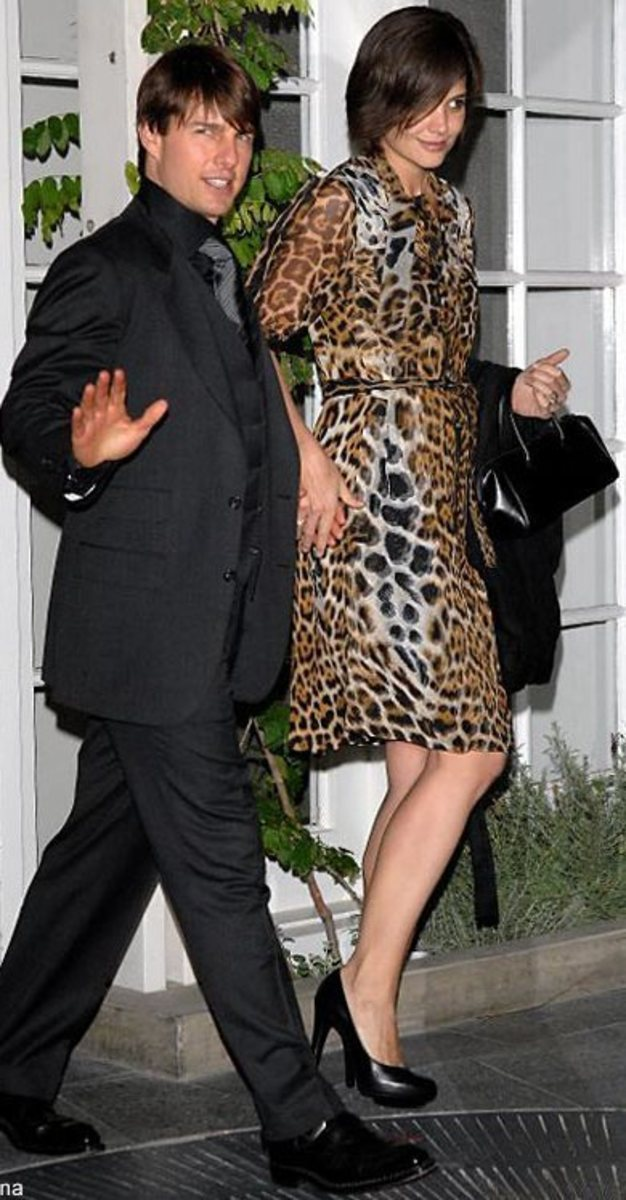 With Tom by her side, Katie does Leopard classic with black accessories
