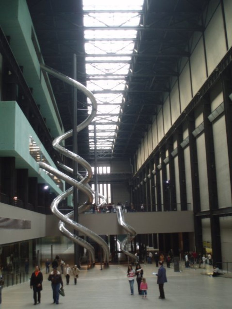 Interior view of the Tate Modern in London, England. Yes they are massive indoor slides.