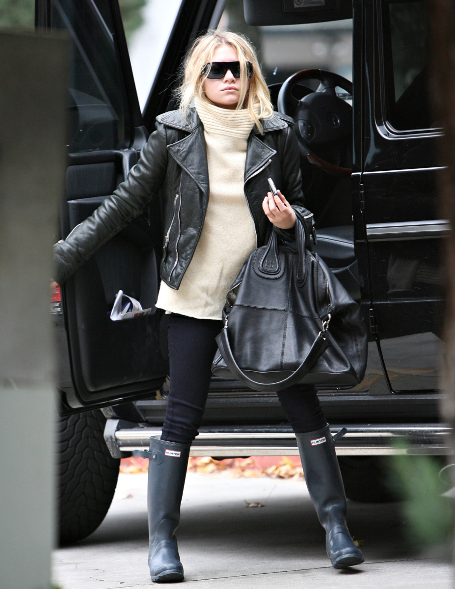 Ashley Olsen was out and about  looking absolutely chic in her  leather jacket and rain boots.