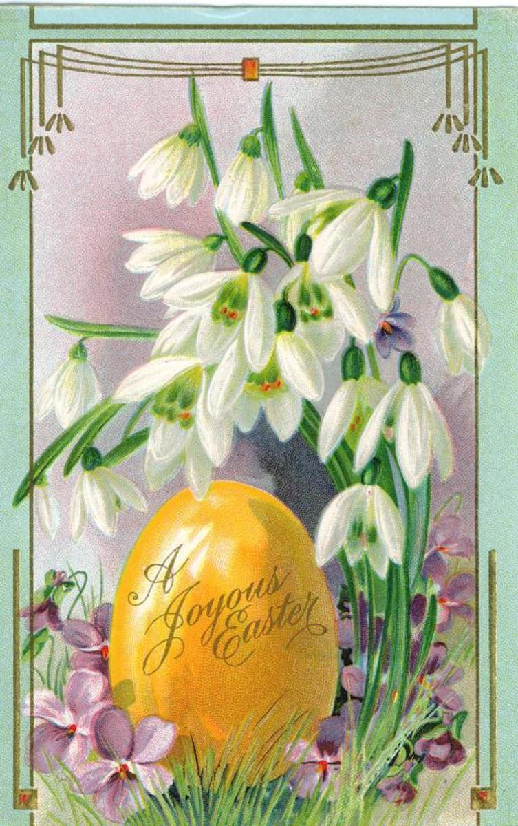"Easter flowers: Large yellow Easter egg with white flowers ""A joyous Easter"""