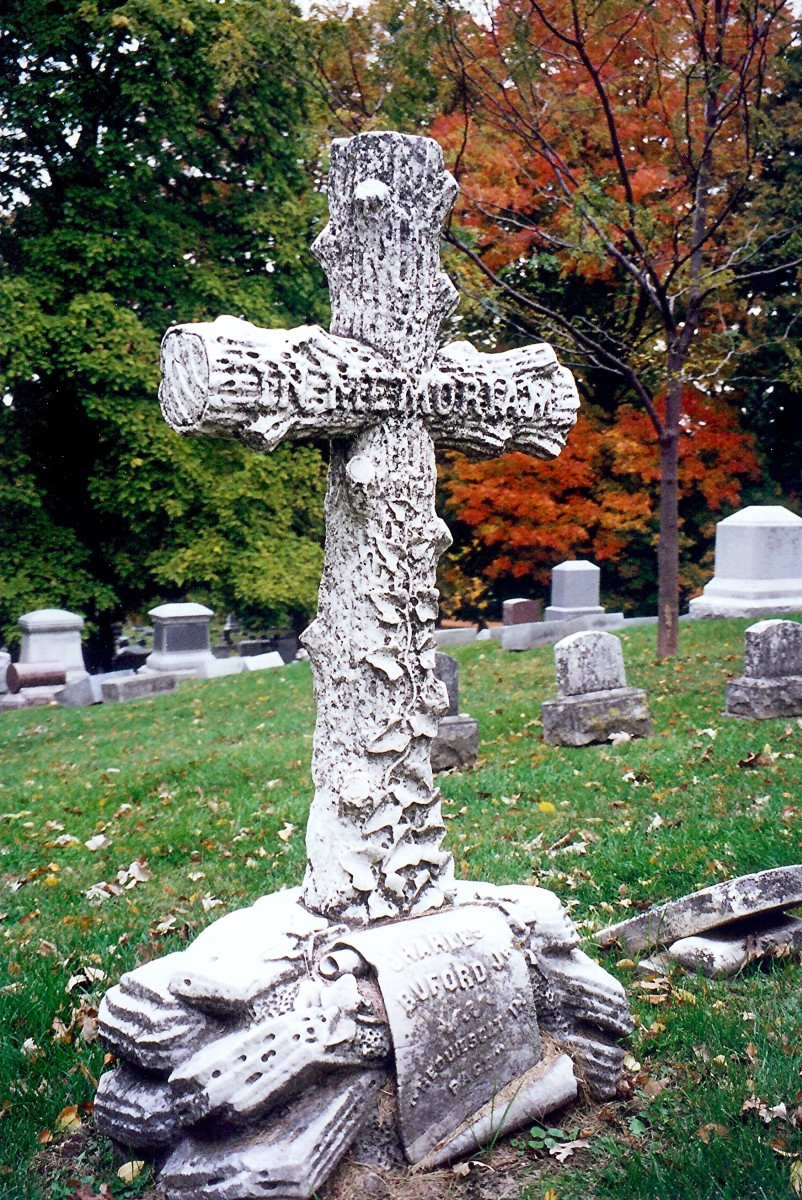Cross simulating logs with ivy growing on it for the Buford monument in Chippiannock Cemetery