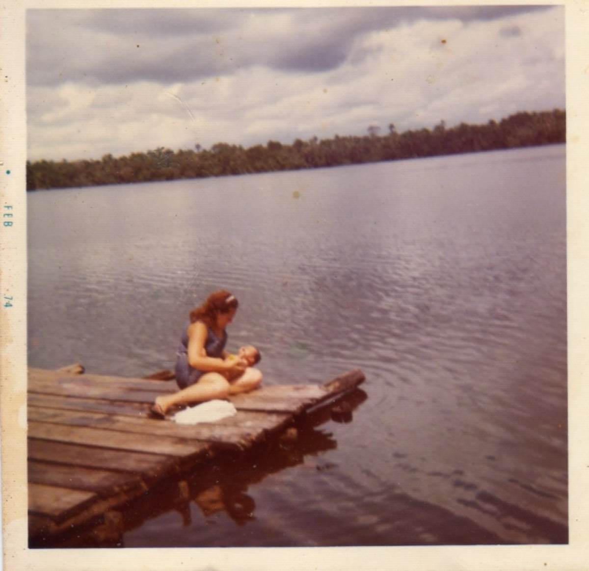 Mom giving me a bath on the Amazon River