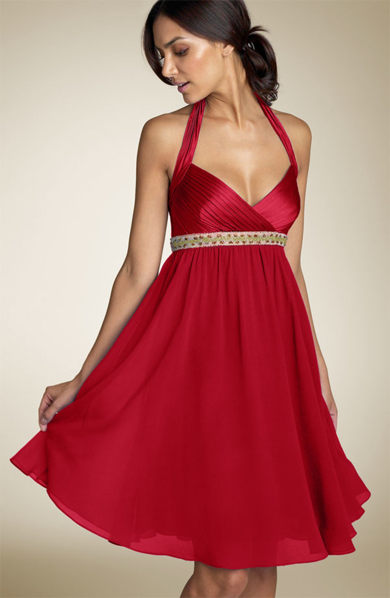 Sleek red cocktail-style wedding dress.