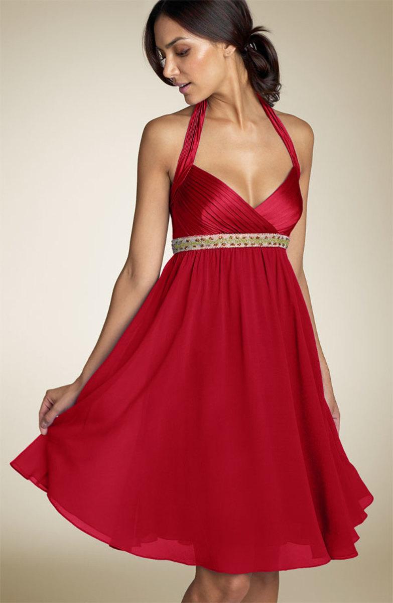 Sleek red cocktail-style wedding dress.