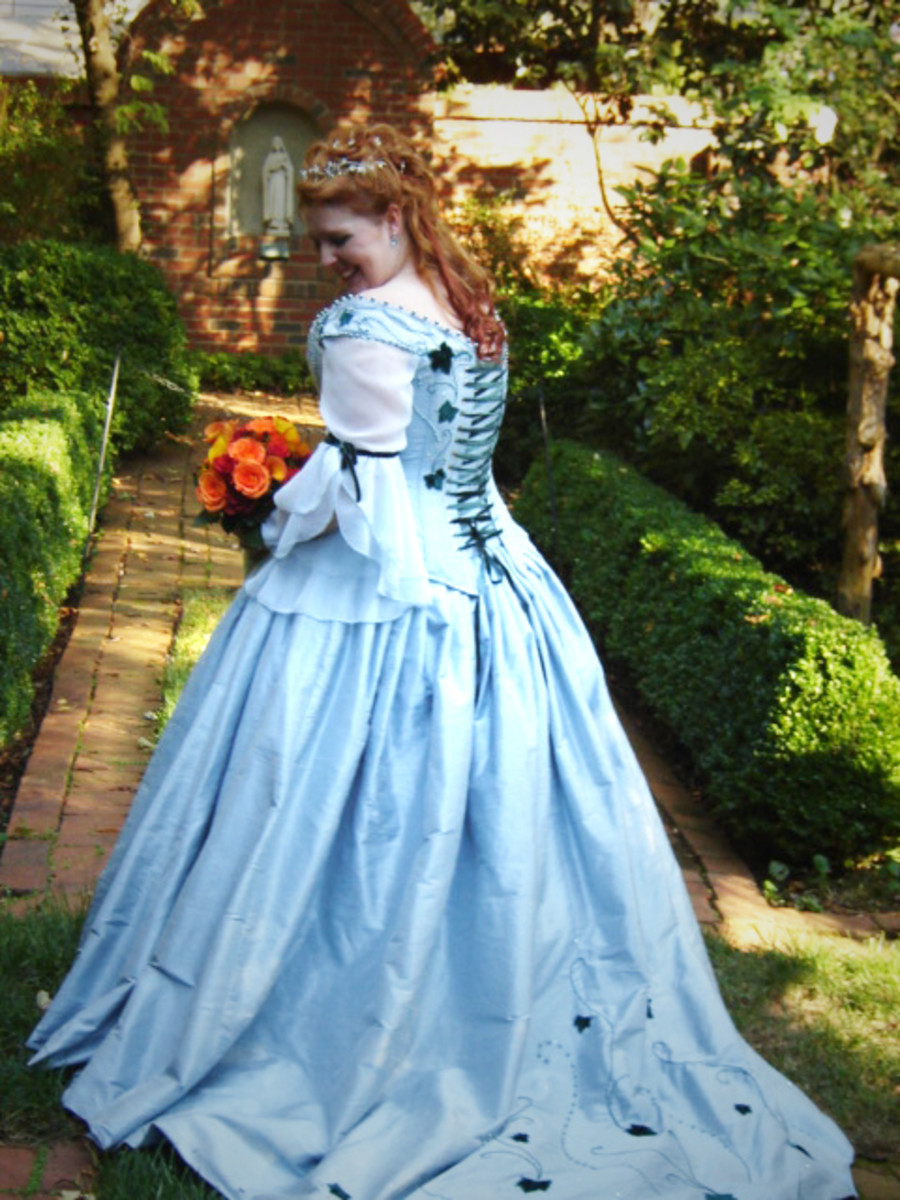 Blue corseted Medieval wedding dress. See more athttp://www.medievalbridalfashions.com.