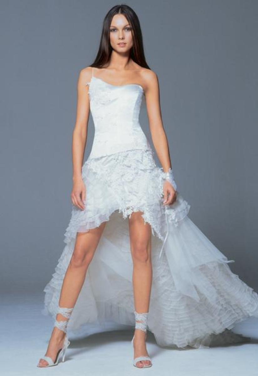Sexy, sleek wedding dress with a long tulle train.