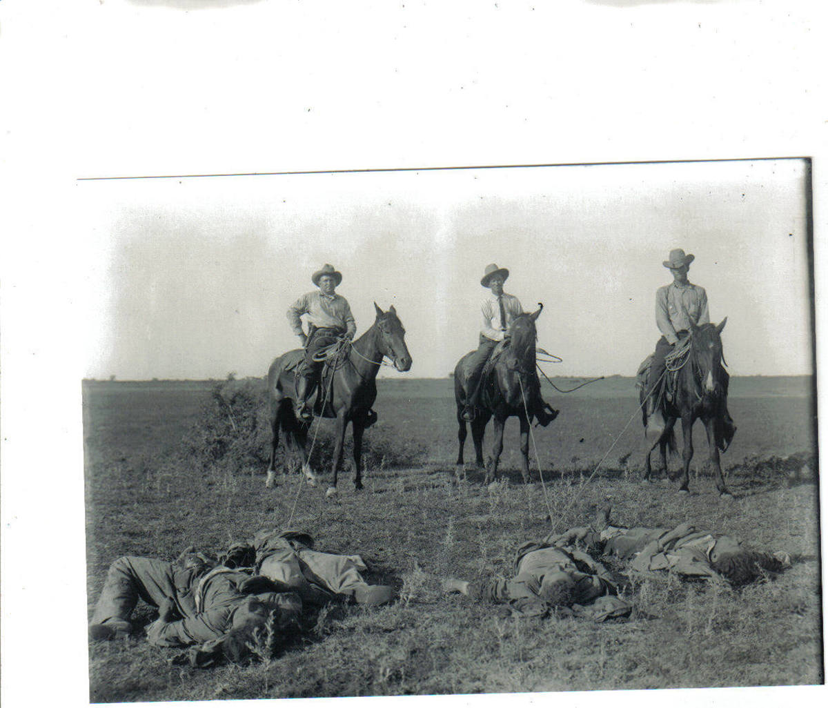 Texas Ranger dragging in Outlaws by rope.