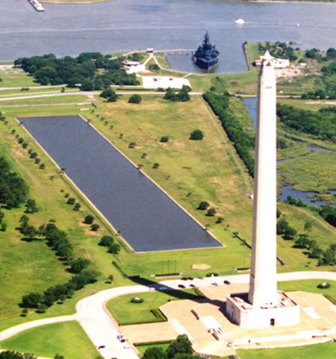 The San Jacinto Monument is a 570 foot high column topped with a 220 ton star that commemorates the site of the Battle of San Jacinto, the decisive battle of the Texas Revolution.