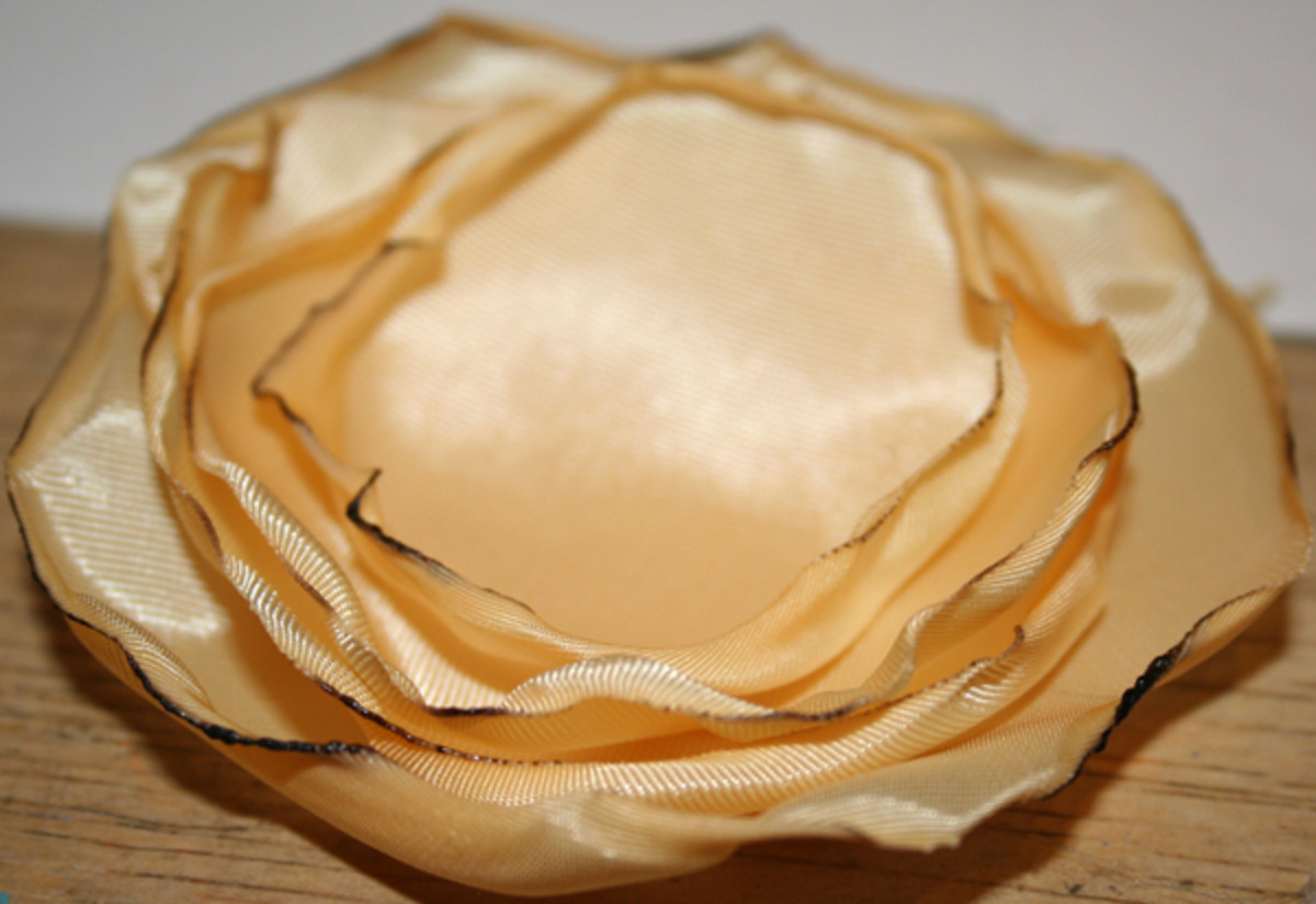 5 yellow flower petals ready for hand-sewing