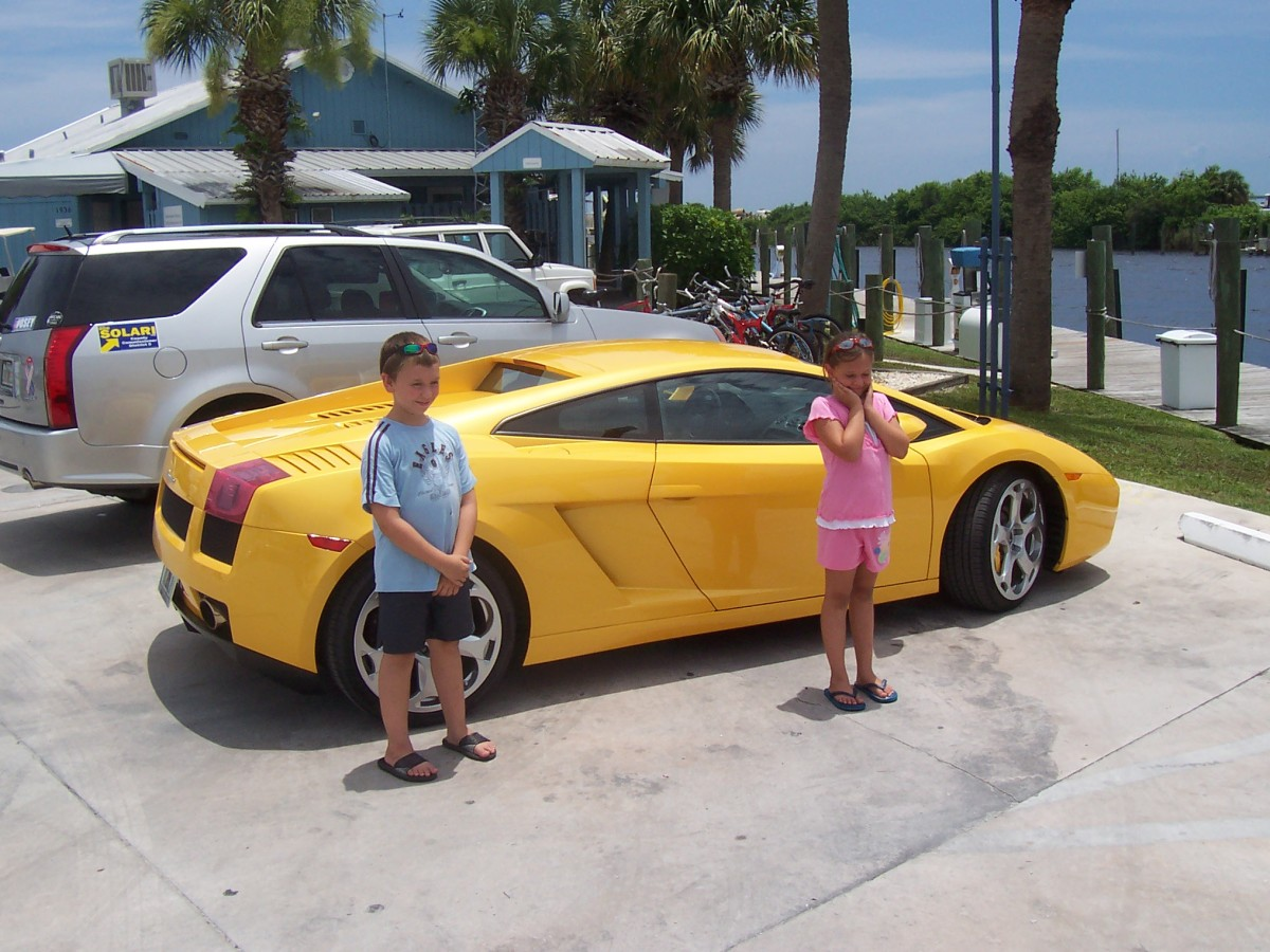 The grandkids with a lamborghini